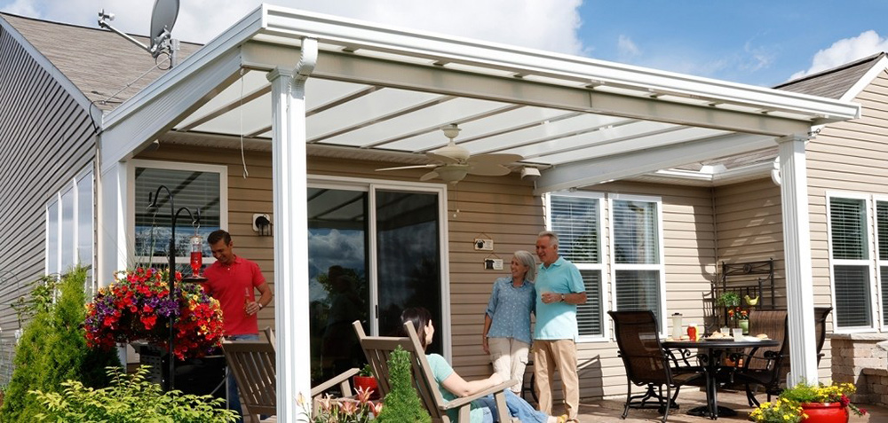 People Standing Under Their Custom Patio Cover